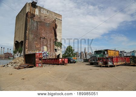 BROOKLYN, NEW YORK - JUNE 4, 2017: Abandoned building and view of Manhattan Midtown from Greenpoint, Brooklyn. Greenpoint is the northernmost neighborhood in the New York City borough of Brooklyn