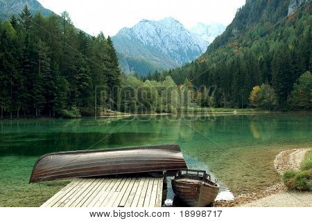 Lake and wooden boats; fall is comming.