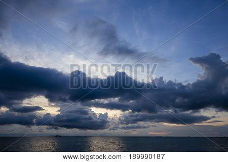 Wonderful dramatic sunset over the sea water at island Koh Phangan Thailand