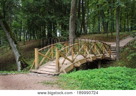 Wooden bridge in park of Trigorskoe village Pushkinskiye Gory Russia