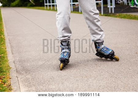 Active Woman Rollerskating Outdoor.