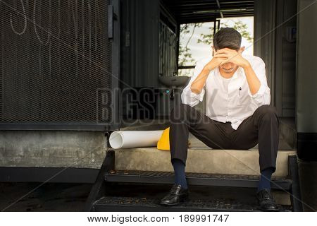 Young businessman feeling stress on his work out of control and failure