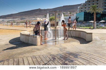 Women Take A Shower After Taking Salt Bath In The Dead Sea
