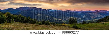 panoramic countryside landscape at sunrise. village in valley view from the hill