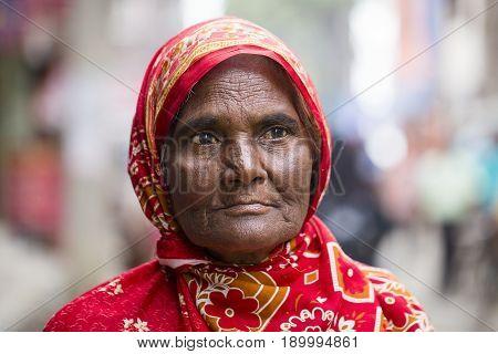KATHMANDU NEPAL - SEPTEMBER 29 2016 : Portrait old women in traditional dress in street Kathmandu Nepal
