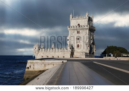 Belem Tower against a dramatic sky in Lisbon Portugal