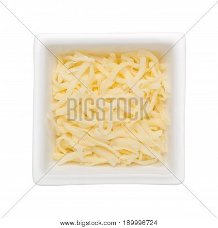 Shredded mozzarella cheese in a square bowl isolated on white background