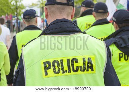 Uniformed Male Police Officers wearing fluorescent vests