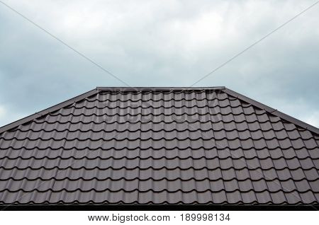 Brown Roof Tiles Or Shingles On House As Background Image. New Overlapping Brown Classic Style Roofi