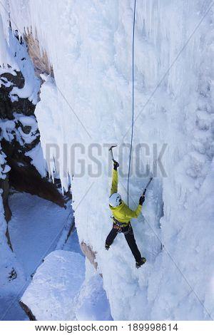 Caucasian climber scaling glacier