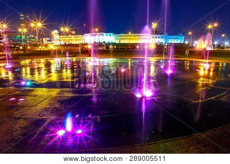 Colorful water fountain at Souq Waqif Park at Doha Corniche illuminated at night. Famous tourist attraction in Doha. Qatar, Middle East, Arabian Peninsula in Persian Gulf. poster
