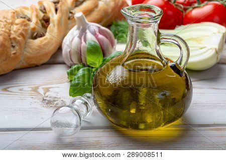 Virgin Natural Olive Oil Is Glass Bottle, Served With Traditional Mediterranean Food
