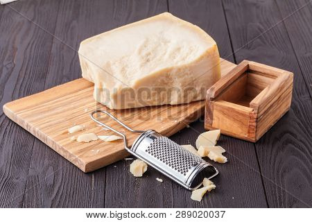 Parmesan Cheese. Grated Parmesan Cheese And Olive Wood Parmesan Cheese Grater
