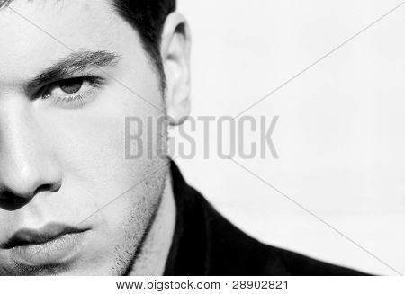 Unshaved handsome man portrait. Black and white isolated on white.