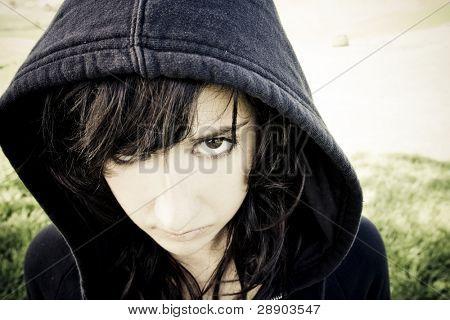 Scary young woman staring at camera.