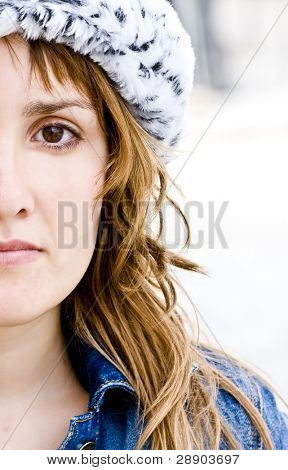 Half face woman portrait isolated in white