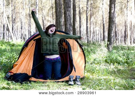 Young montaineer waking up in the morning
