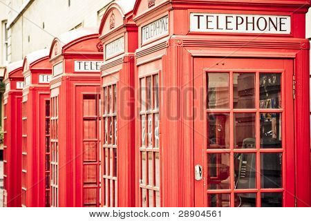 Five red phone boxes, grunge toned poster