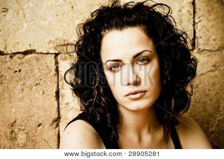 Green eyed beautiful woman with pierced lip