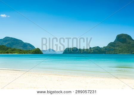 Fabulous Exotic Beach With White Sand And High Palm Trees