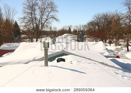 Snow Covered Roofs After Heavy Snow Storm In Eastern North Dakota.
