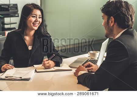 Businessman And Businesswoman In Meeting Room.