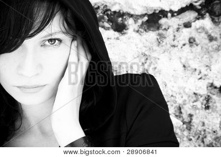 Young woman staring at camera, high contrasted black and white.