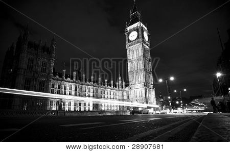 Nocturne scene with Big Ben behind light beams, dark toned.