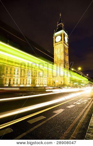 Nocturne scene with Big Ben behind light beams.