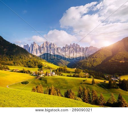 Splendid landscape in St. Magdalena or Santa Maddalena village. Location place Val di Funes (Villnob), Dolomite alps, Trentino-Alto Adige, Italy, Europe. Famous resort. Discover the beauty of earth.