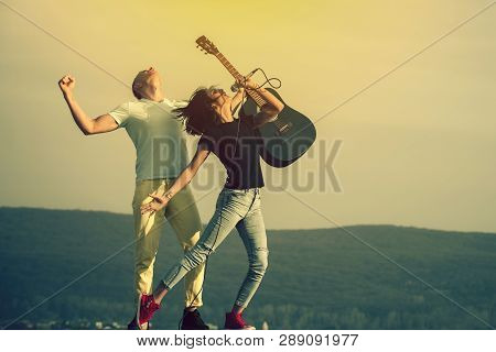 Young Couple Of Musicians Performing On Natural Stage. Pretty Woman, Singer Or Girl Singing To Mic A