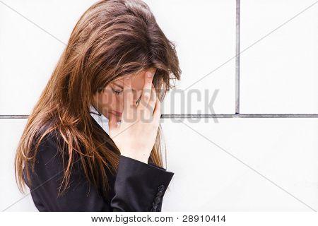 Worried businesswoman showing her desperation