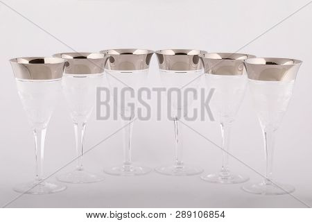 Stemware Faceted Glasses Made Of Czech Glass With A Silver Lines And Patterns Isolated On A White Ba