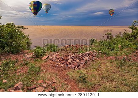 Hot Air Balloons Over The Rio Parana, A Border River Between Paraguay And Argentina At The Blue Hour