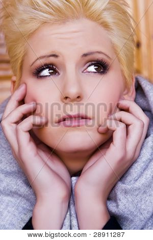 Woman portrait expressing afraid or worry poster