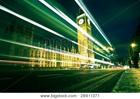Nocturne scene with Big Ben behind light beams, dark toned.