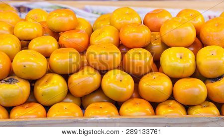 Asian Or Japanese Persimmon (persimon) Fruits Are Sweet Flavored With Soft Fibrous Texture, Not Astr