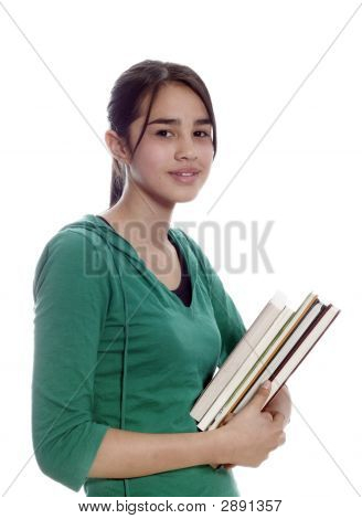 A Young Student Smiling And Carrying Notebooks