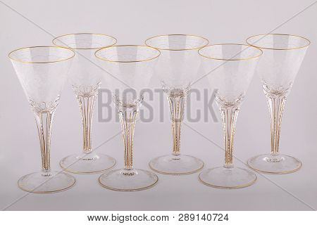 Stemware Faceted Glasses Made Of Czech Glass With A Golden Lines And Patterns Isolated On A White Ba