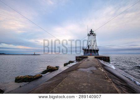 Ludington Lighthouse. Lighthouse On The Coast Of Lake Michigan Under An Overcast Grey Sky.