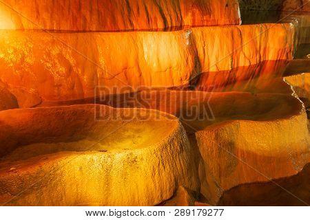 Cave Lake Nature Background. Amazing Cave Lake Nature Background. Artificial Orange Lights In Cave.