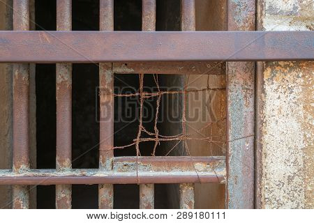 Closeup Of A Closed Rusted Iron Bars Of Cell Door In Closed Abandoned Prison At Cairo Citadel, Egypt