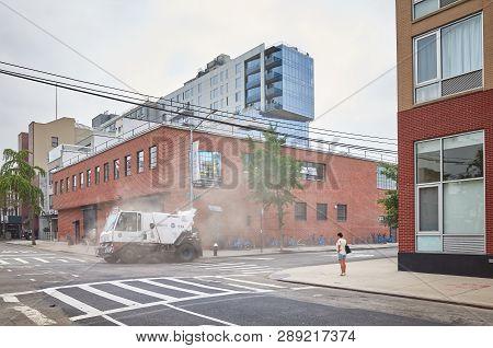 New York, Usa - July 04, 2018: New York City Sanitation Department Vehicle On 5th Street In Long Isl