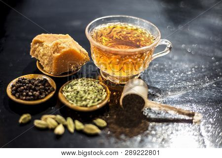 Close Up Of Popular Type Of Tea On Wooden Surface Earlier Dunked A Lot I.e. Jaggery Tea With Ingredi