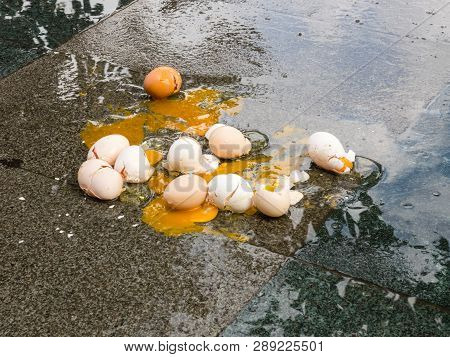 Broken Eggs On Wet Asphalt, Bad Day In Rainy Weather.