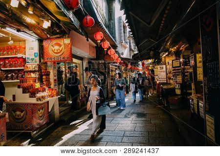 Jiufen, Taiwan - November 07, 2018: A Young Woman Walks With Purchases At The Old Street Market On N