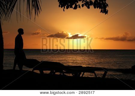 Sunset With A Man In Silhouette