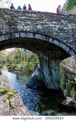Betws Y Coed, Uk - Feb 2, 2019: The Pont-y-pair Bridge In Betws-y-coed Crosses The Afon Llugwy River