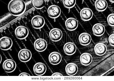 Antique Typewriter - An Antique Typewriter Showing Traditional Qwerty Keys I