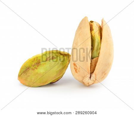 Pistachio Torn To Pieces With Whole Pistachio Isolated On White